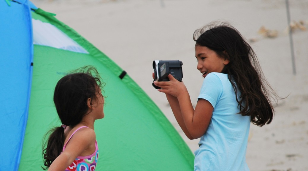 two children and a camera